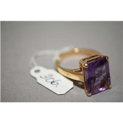 Ladies 10kt yellow gold and amethyst ring, set with 10.00ct faceted rectangular shaped amethyst. Ret