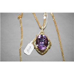 Ladies 10kt yellow gold, amethyst and diamond pendant, set with 26ct oval faceted amethyst gemstone