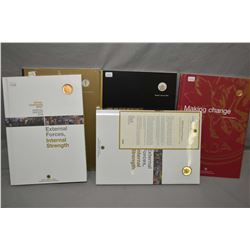 Five Royal Canadian Mint annual report portfolios with collector's coinincluding 2003, 2004, 2005 an