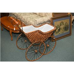 Victorian style woven wicker doll's pram on spring metal framed and spoked wooden wheels