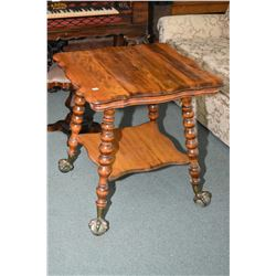 Heavy antique two tier occasional table with bobbin turned supports and cast and glass ball and claw