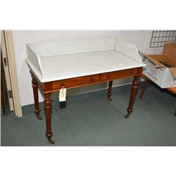 Marble top washstand with two faux drawers and porcelain castors, perfect for repurposing for bathro