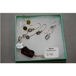 Selection of brand new sterling silver including red cherry amber pendant, two pairs of amethyst ear