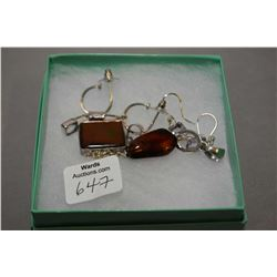 Selection of brand new sterling silver jewellery including ammolite pendant, gemstone earrings, and