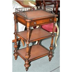 Modern mahogany three tier open shelf with single drawer and attached cast galley and leather inset