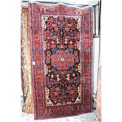 100% wool carpet with overall geometric pattern, multiple border, stylized foliage, center medallion