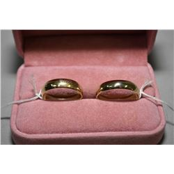Pair of 14kt yellow gold wedding bands. Retail replacement value $675.00 and $750.00