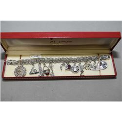 Sterling silver charm bracelet with twelve charms