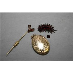 Two vintage gold and garnet pins including stick pin and small brooch and loose garnet gemstone and
