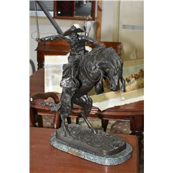 "Remington bronze ""Bronco Buster"" on marble base, 23"" in height"