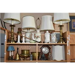 Two shelf lots of collectibles including brass and pottery table and bedside lamps, candlesticks, br