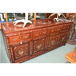Exquisite Asian sideboard with four doors and four drawers and each visible panel is beautifully inl