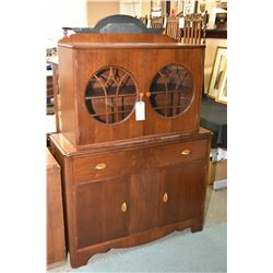 Art Deco walnut china cabinet with drawer and doors in base and two doors with round glass panes and