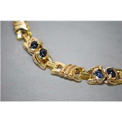 Ladies 14kt yellow gold link bracelet with eight oval shaped cabachon cut blue sapphires. Retail rep