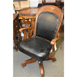 Antique oak open arm swivel office chair, appears to original leather upholstery and finish