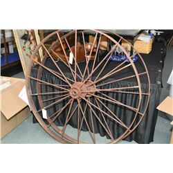 "Two antique impliment wheels over 50"" diameter"