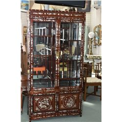 Exquisite Asian china cabinet with multiple level glass shelves and two door storage in base each vi