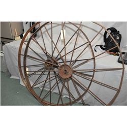 """Two antique impliment wheels over 50"""" diameter"""