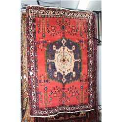 100% wool area carpet with center medallion, stylized foliage in shades of red, blue, green, cream e