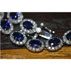 Ladies brand new14kt white gold, diamond and sapphire necklace, set with 39 oval shaped natural sapp