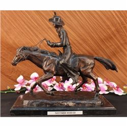 Seasoned Cowboy Riding Bronze Sculpture