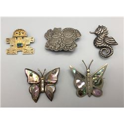 Group Of 4 Pins And A Pendant