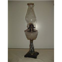 1890's figural coal oil lamp