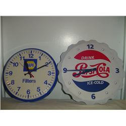 2 advertising clocks pepsi (battery) and napa (plug in)