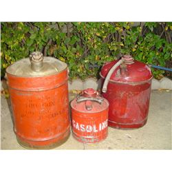 3 old gas containers