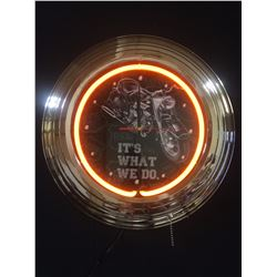 """IT'S WHAT WE DO"" NEON WALL CLOCK"