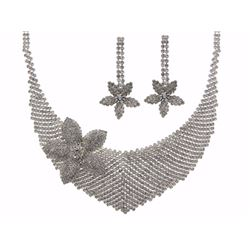 Lady's Necklace with matching earrings. Two prong set oval cut swarovski elements. Seven prong set r