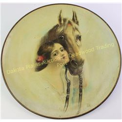 "Early tin charger with great artwork of girl and horse, unmarked, 16"" diameter.  Est. 75-175"