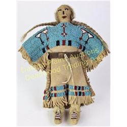 "Northern Plains beaded on leather doll 8"" tall, sinew sewn with white centered reds, blues and white"