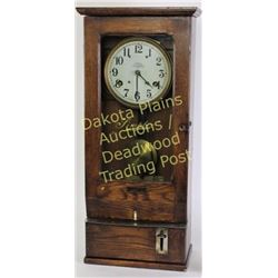 Oak cased Simplex time clock with original finish in good working order at time of description, 31""