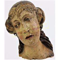 "Early carved wood head of a female polychromed, 8"" tall.  Est. 200-400"