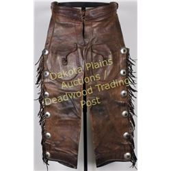 Fred Mueller stamped cowboy shotgun chaps, fringed, 6 cohchos on each leg with outside pockets, chap