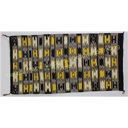 "Nicely accomplished Navajo rug in geometric patterns, browns, yellow and white, 27"" X 54"", shows exc"