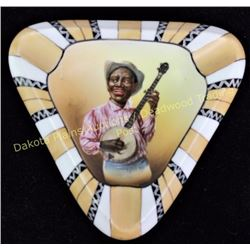 "Scarce Nippon ashtray with blackman banjo player marked with M in wreath, 6"" X 6"", shows excellent c"