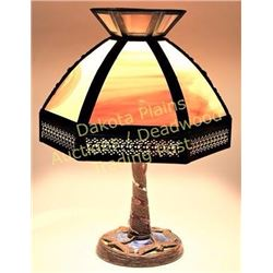 Table lamp with bronze dragonfly base and 6 panel bent glass shade.  Est. 125-200