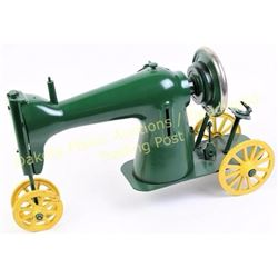 "Unique repurposed singer sewing machine crafted into a farm tractor, 18"" long.  Est. 150-250"