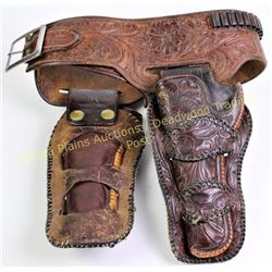 "Heiser stamped double buscadero holster rig fitting Colt SA 4 3/4 or 5 1/2"" .32 caliber.  Est. 150-3"