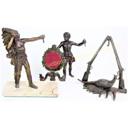 Collection of 3 pocket watch stands all cast metal including Indian Chief, small boy and shotguns ov