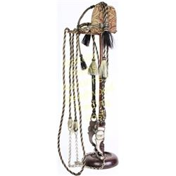 Hitched horsehair bridle in white, black and brown with tassels, round cheeks, close reins and great