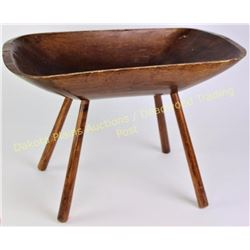 "Wood primitive dough bowl on legs, 15"" X 21"".  Est. 50-150"