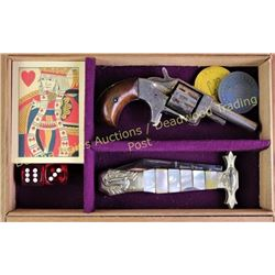Cased gamblers set in Deadwood Tobacco Co cigar box, with antique Defender spur trigger scarlett gun