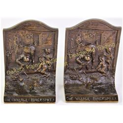 "Arts and Crafts period bookends in solid copper ""The Village Blacksmith"".  Est. 25-75"