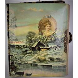 Victorian celluloid photo album with wonderful winter cabin scene front.  Est. 25-100