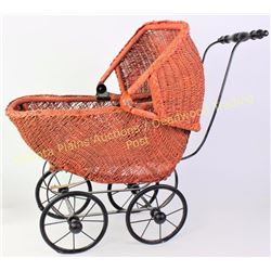 "Victorian wicker doll buggy with hinging bonnet, 27"" long.  Est. 75-175"