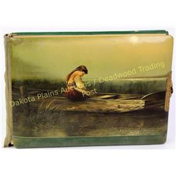 Victorian celluloid photo album depicting young girl in wooden boat.  Est. 50-100