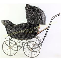 "Antique Victorian wicker doll buggy showing very good condition, complete, 29"" tall.  Est. 75-175"